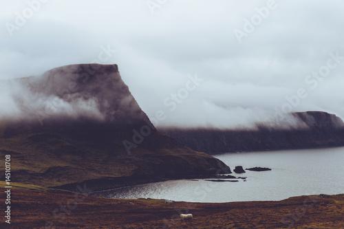 Fotografia Misty cloud on coast of Isle of Skye Scotland