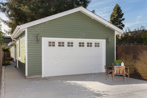 Canvas-taulu Side view of house exteriors and garage entrance