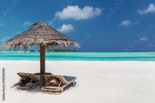 palapa and sunbeds on maldives beach Poster Mural XXL