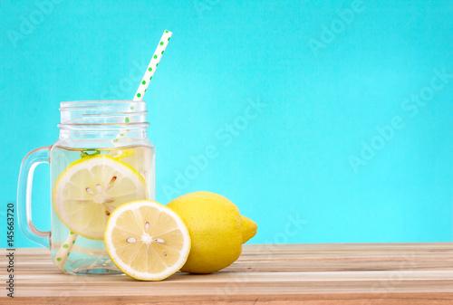 Tablou Canvas Citrus lemonade water with lemon sliced , healthy and detox water drink in summ
