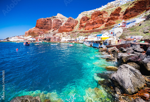 Canvas Print The old harbor of Ammoudi under the famous village of Ia at Santorini, Greece