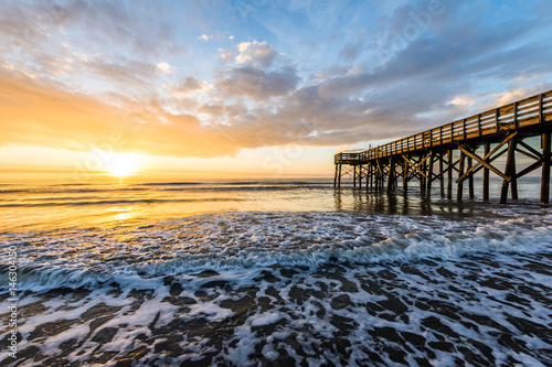 Fotografia, Obraz Isle of Palms Pier at sunrise in Charleston, South Carolina