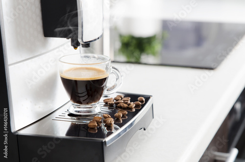 Fotografija Home professional coffee machine with espresso cup.