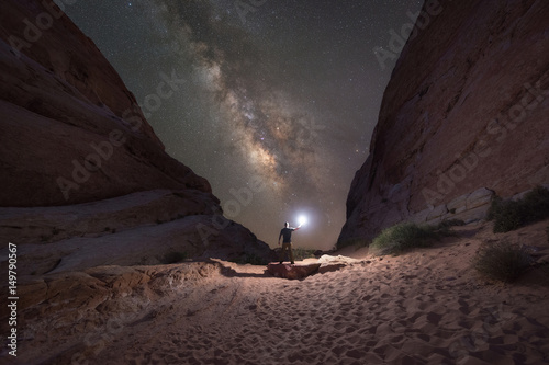 Fotografie, Tablou Man lighting up White Domes in Valley Of Fire State Park