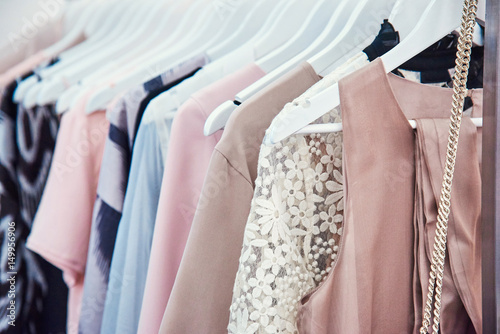 Fotografering Details of bright beautiful pastel tones dress collection in show room