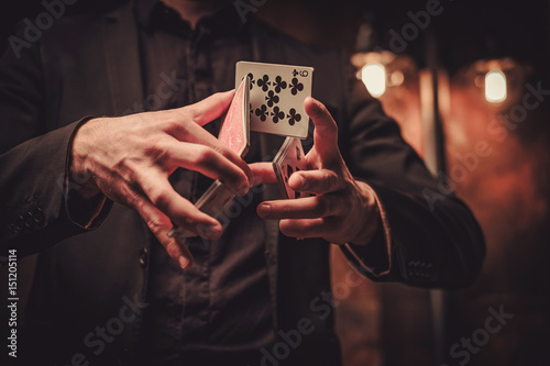 Photo Man showing tricks with cards