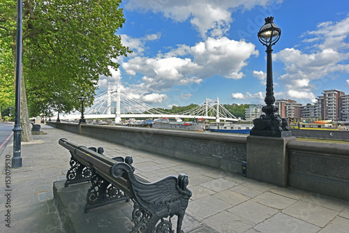 Leinwand Poster Chelsea Embankment on the River Thames and Albert Bridge with summery, blue, cloud flecked sky