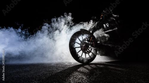 Vászonkép High power motorcycle chopper with man rider at night
