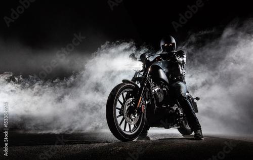 Valokuvatapetti High power motorcycle chopper with man rider at night