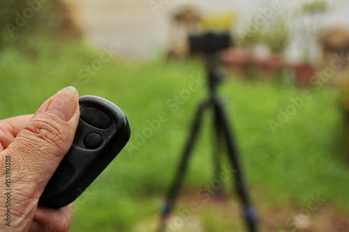 Fototapeta Use the remote to press the self-portraits.