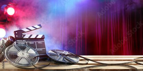 Obraz na płótnie Film movie Background - Clapperboard And Film Reels In Theater