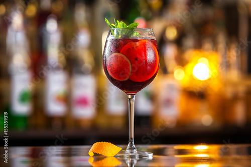 Closeup glass of red wine  fresh sangria at bright bar counter background Fototapeta
