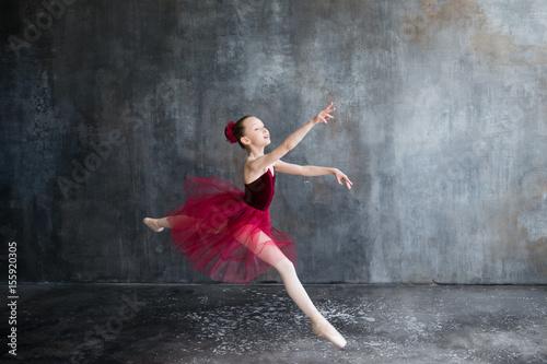 Leinwand Poster girl ballerina in red tutu doing exercise