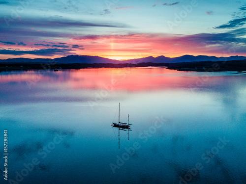 Obraz na płótnie Aerial of an amazing sunset with sailing vessel Loch Creran, Barcaldine, Argyll