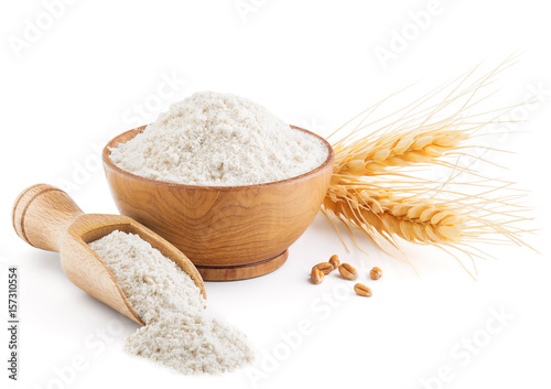 Fotografiet Whole grain wheat flour and ears isolated on white