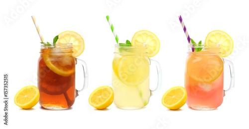 Fototapeta Three mason jar glasses of summer iced tea, lemonade, and pink lemonade drinks i
