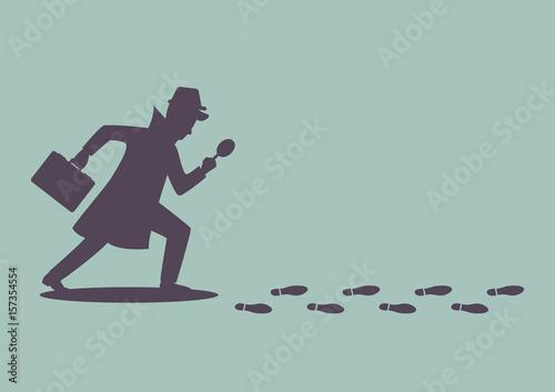 Silhouette of detective investigate is following footprints Fototapeta