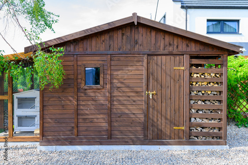 Fotografia Garden shed exterior in Spring, with woodshed