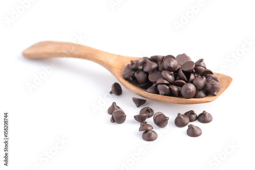 Fotografie, Obraz Dark chocolate chips in spoon isolated on white background.