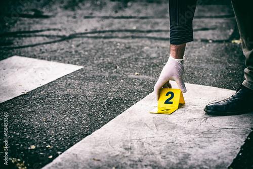 Tableau sur Toile Putting the crime scene marker on the asphalt