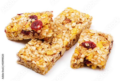 Broken healthy granola bar (muesli or cereal bar) isolated on white background Fototapeta