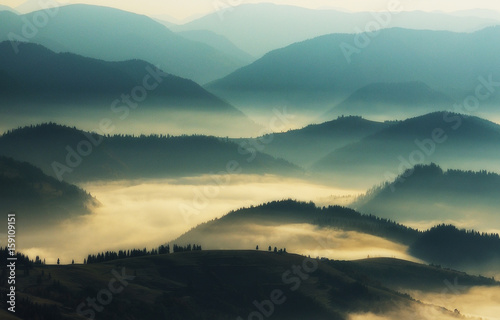 Silhouettes of mountains. A misty autumn morning. Dawn in the Carpathians