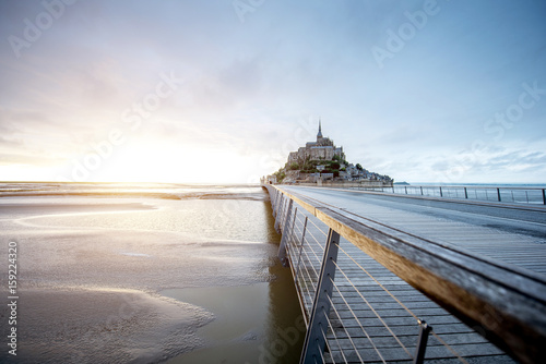 Obraz na plátně Sunset view on the famous Mont Saint Michel abbey with bridge during the tide in