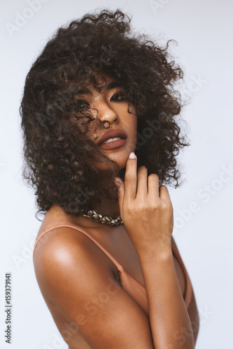 Studio portrait ethnic dark skin female model in bikini