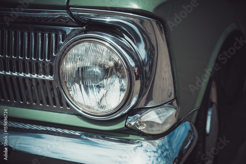 Wallpaper Mural Headlights and body of an old classic car at an exhibition of vintage cars