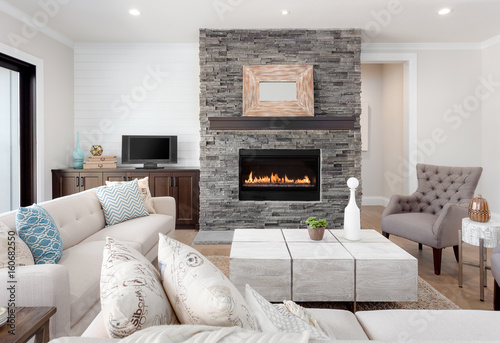 Stampa su Tela Beautiful living room interior with hardwood floors and fireplace in new luxury home