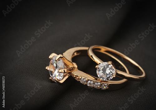 Fényképezés jewelry rings with diamond on black cloth, soft focus