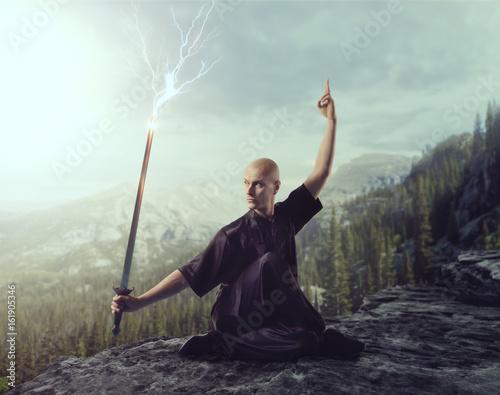 Fotografering Wushu master with blade, lightning control