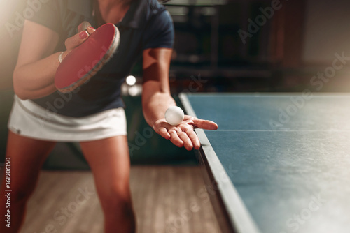 Table tennis, female player with racket and ball