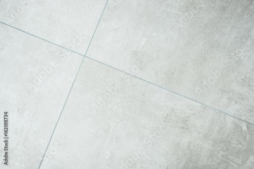 Foto grey stone tile background  - concrete style stoneware