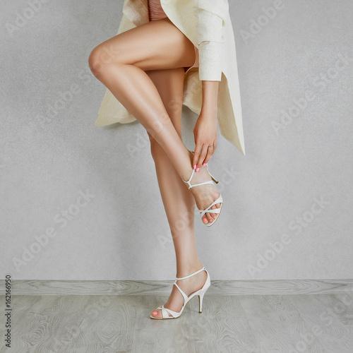 Fotografie, Tablou Long bare woman legs in high heel beige sandals
