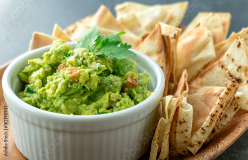 Mexican guacamole dish. Guacamole is a avocado based dip, traditionally a mexican (Aztecs) dish. Healthy and easy to make at home with a few simple ingredients. Excellent as party food or at bars.