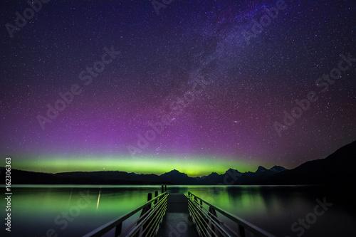 Fototapeta Northern Lights and Milky Way over Lake McDonald, Glacier National Park, Montana