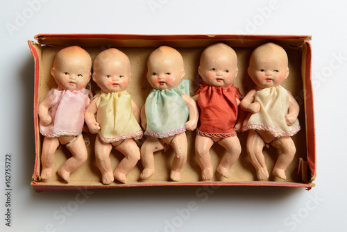 Set of little vintage dolls, packed in a tiny box Fototapeta