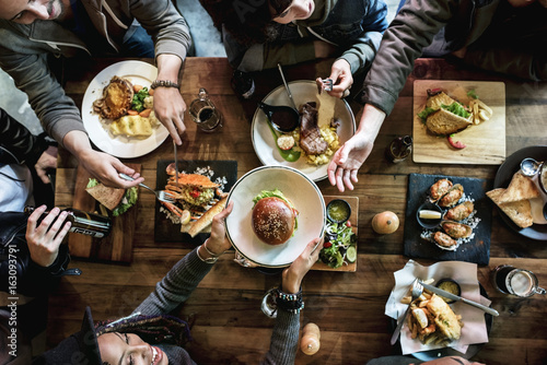 Fényképezés Friends all together at restaurant having meal