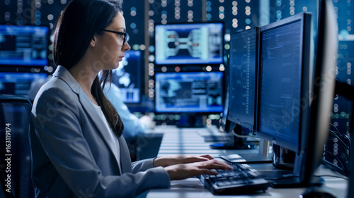 Obraz na płótnie Female Engineer Controller Observes Working of the System
