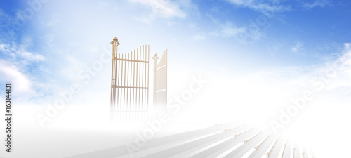 Foto Gates of heaven above stairs in fog with blue sky background