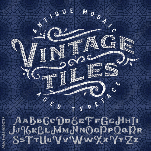 Photo Vintage antique mosaic typeface made of hundreds of aged tiles