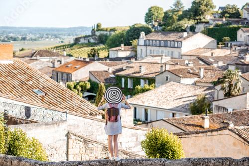 Tablou Canvas Beautiful sunset view on Saint Emilion village with woman tourist in Bordeaux re