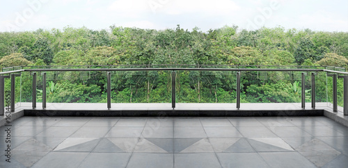 Canvas Print Panoramic view of a green forest canopy from a modern glass balcony