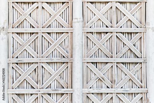 Fototapeta White bamboo wicker shutters of window. Bali style exteriour