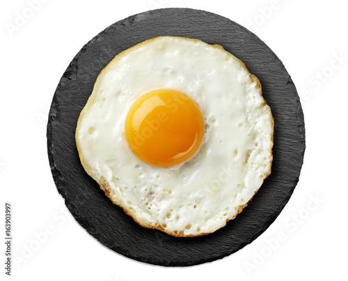 fried egg on round black slate