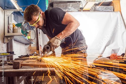 Obraz na plátne welder  grinder metal an angle grinder