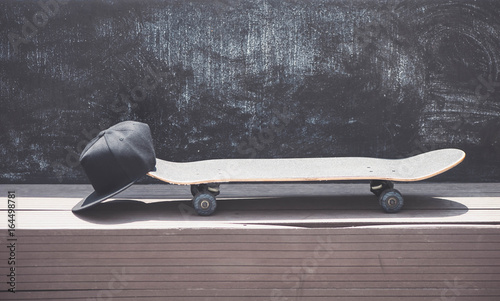 Canvas Print Close-up view of the skateboard with a cap