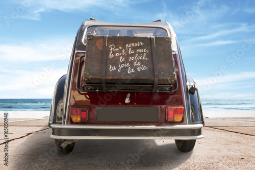 Vintage typical french car near the sea, summer holiday Fototapeta