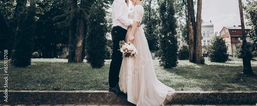 Fotografia, Obraz stylish wedding bride and groom in sunny park, sensual moment